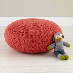 Land of Nod crochet coral salmon pink red pouf